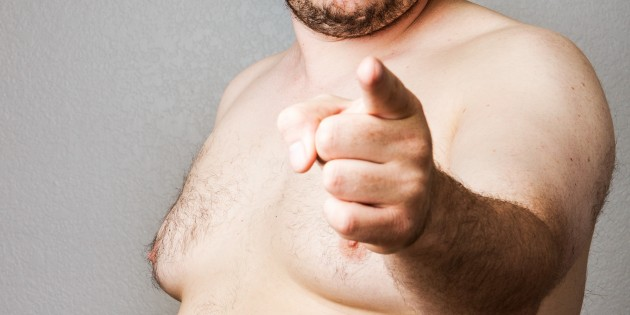 Fat naked man pointing firmly