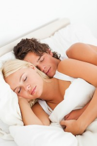 Couple hugging while sleeping